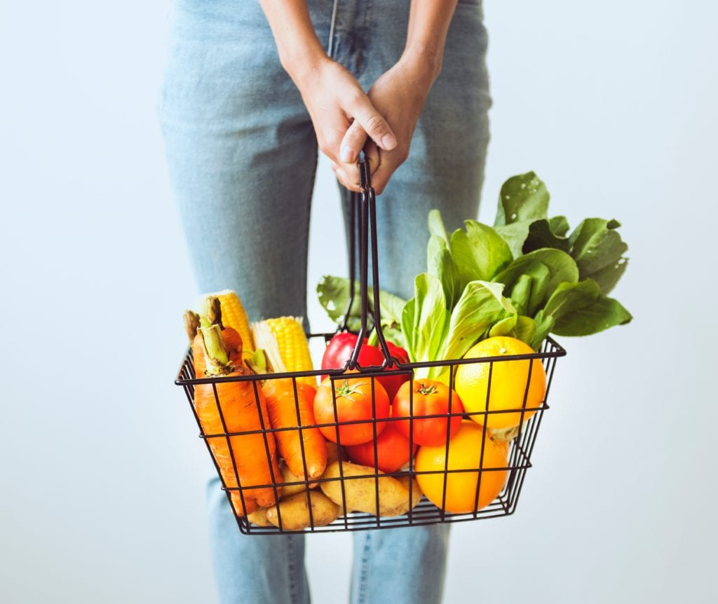 How to become a certified health and wellness coach women holding basket of vegetables